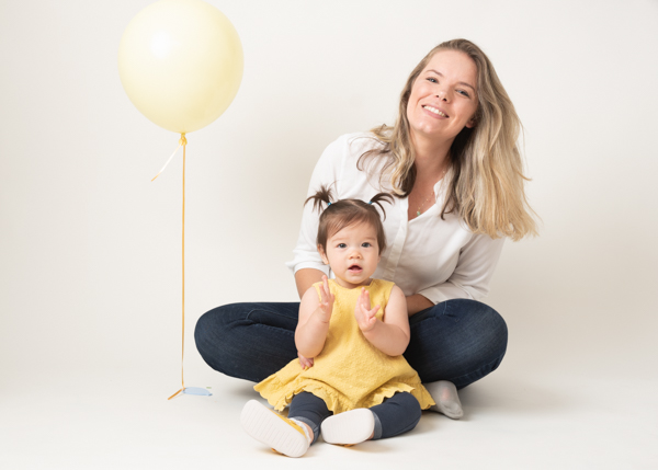 mother and her stunning daughter with a balloon