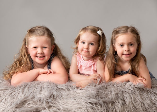 three sisters facing camera kids photoa