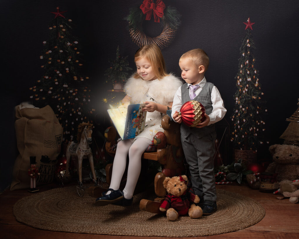 Brother and sister in smart Christmas clothes