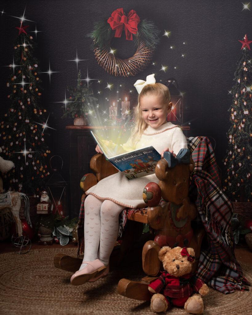 Christmas surprise girl reading magical Christmas book