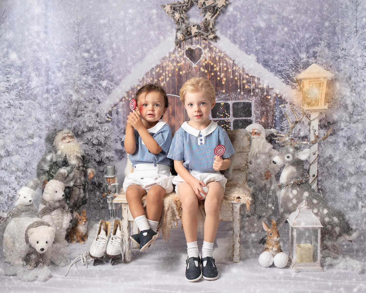 two brothers in winter wonderland in matching blue and white Spanish outfits