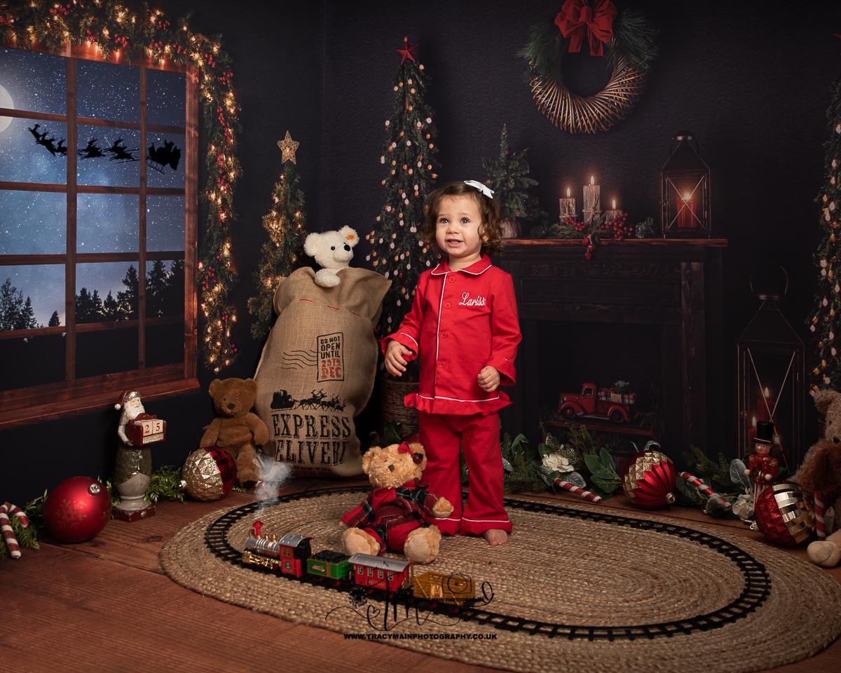 Girl in red Christmas pyjamas on Christmas Eve
